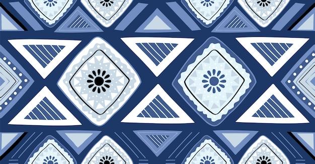 アフリカスタイルの青の幾何学的なシームレスパターン