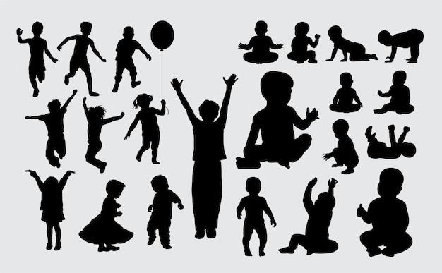 子供と赤ちゃんの活動のシルエット