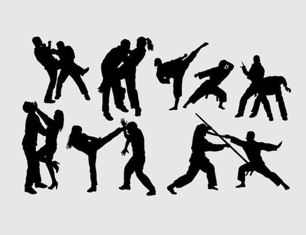 男性と女性のジェスチャーシルエットを戦う