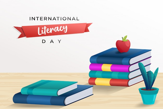 本の山と国際識字デーのポスター