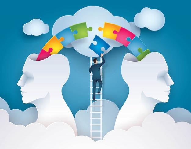 ビジネスマンは、一緒にカラフルなジグソーパズルのピースの作品を押し上げるはしごを登る