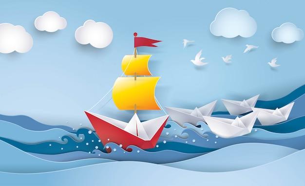 海の赤と白の帆船