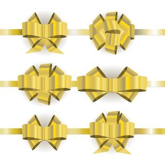 白い背景に分離された異なる黄金の弓を設定します。
