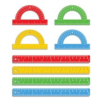 白で隔離される色分度器でインチとセンチメートルでマークされた現実的なカラフルな定規のセット