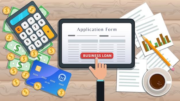 オンラインビジネスローンまたは融資。住宅ローン。ローン申請書と机の上の手クリックボタンを持つフラットタブレット