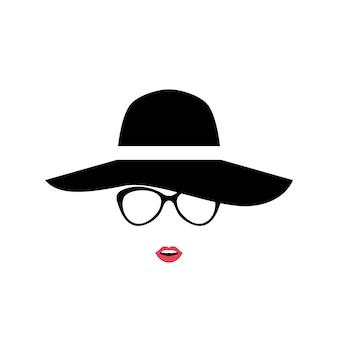 スタイリッシュな帽子とメガネの女性の肖像画。
