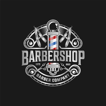 Парикмахерская логотип современный винтаж с ножницами и бритвой