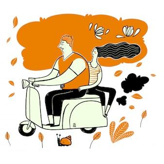 カップルに乗るスクーター。