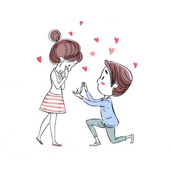 ひざまずいている男が、彼女に結婚するように頼むためにリングを提示する。