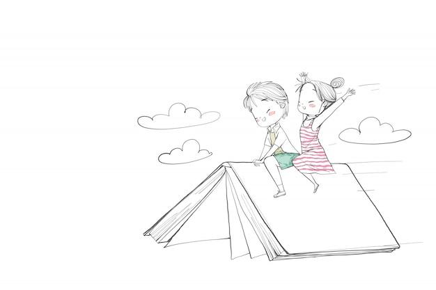 かわいい子供たちが本に乗っています。