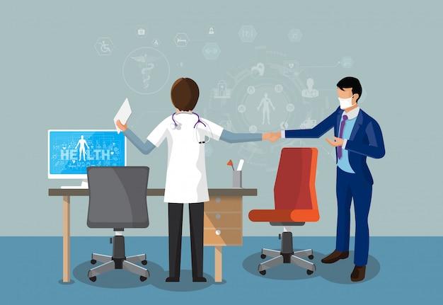 医者と患者の立っている事務机と作業で握手します。