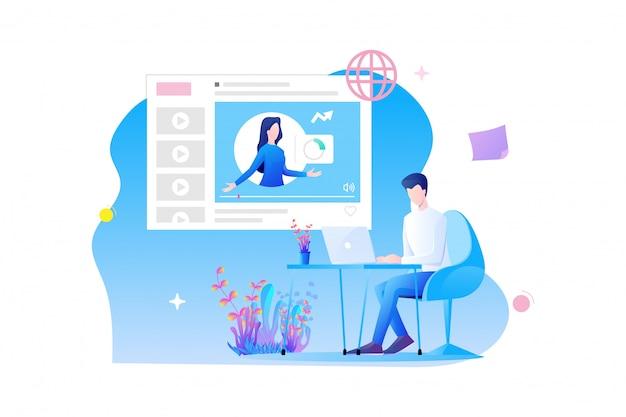 オンライントレーニングのフラットデザイン男のキャラクターは、オンラインコースとオンライン試験の概念でオンライン勉強机に座っています。