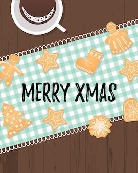 冬の休日の伝統的なクッキーとメリーのクリスマスのテキスト