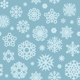 クリスマスシームレスな青い柄の雪片