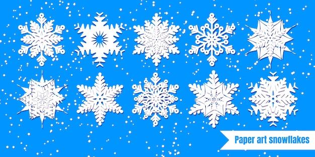 Белые снежинки установлены. бумага вырезать. векторная иллюстрация зимний набор для украшения на новый год и рождество.