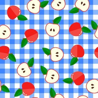 シームレスなパターン。赤いリンゴと半分の背景。