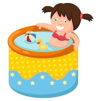膨脹可能なプールの女の子