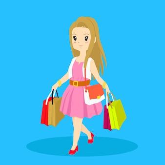 買い物袋を運ぶ買い物中毒の女性