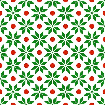 グリーンの赤い色で抽象的な幾何学的な飾りとクリスマスのシームレスパターン