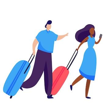 乗客用ホイールスーツケースのカップル