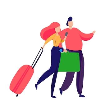 スーツケースを運ぶ乗客のカップル