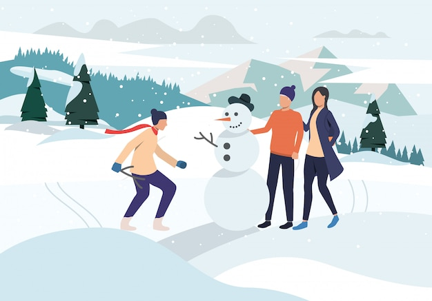 Люди делают снеговика