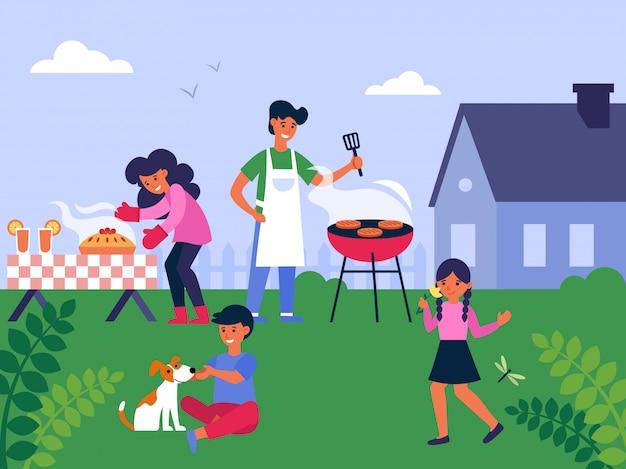 Семья готовит барбекю на заднем дворе
