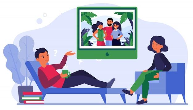 心理学者と彼の家族を議論する男