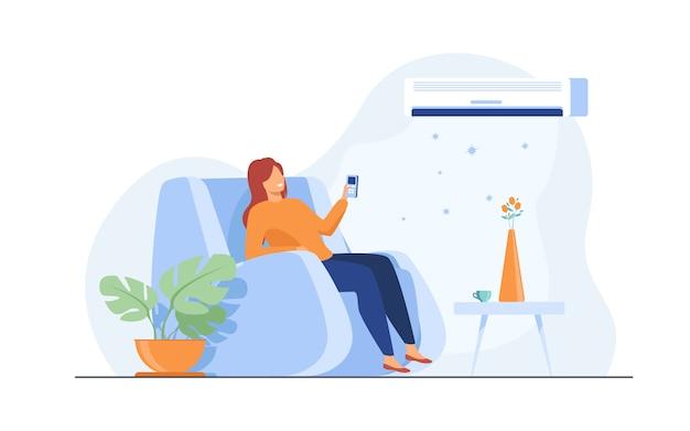 Женщина расслабляющий в кресле у себя дома