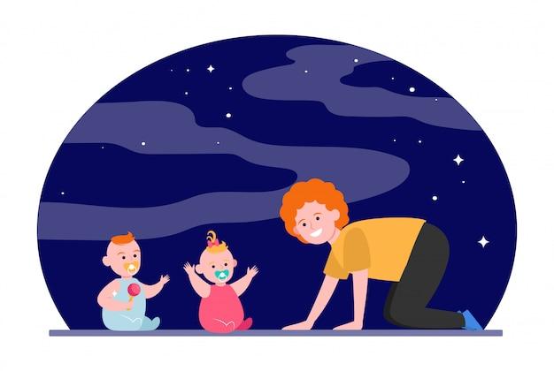 双子の赤ちゃんと遊ぶ陽気なママ