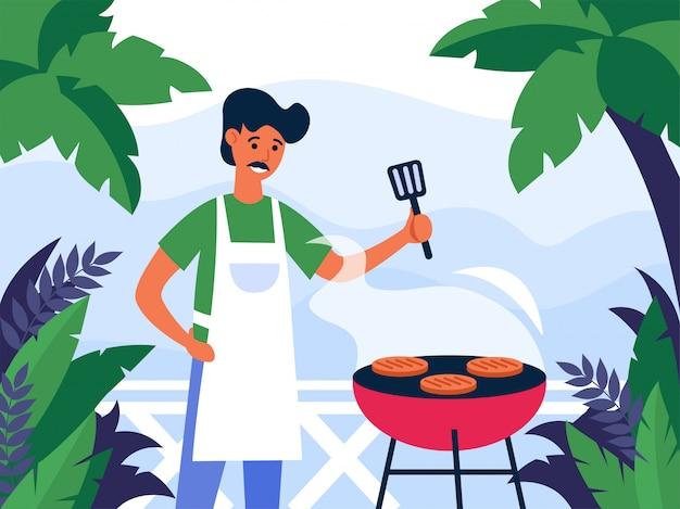 屋外でステーキを焼く男