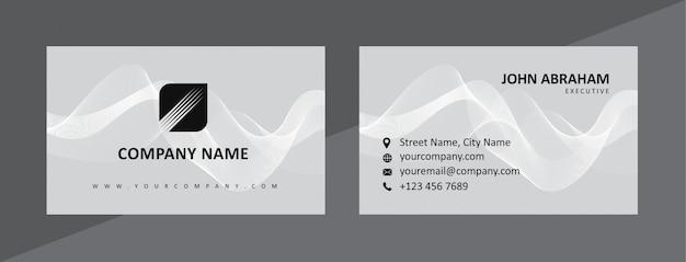 Динамический натуральный черный & серый шаблон визитной карточки