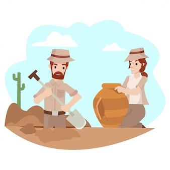 男性の考古学者は宝物が置かれている場所を掘っています