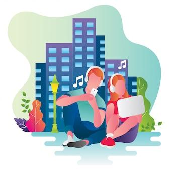 Музыка пар слушая использует наушники и компьтер-книжку в столице.