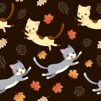 猫と秋の葉のシームレスパターン