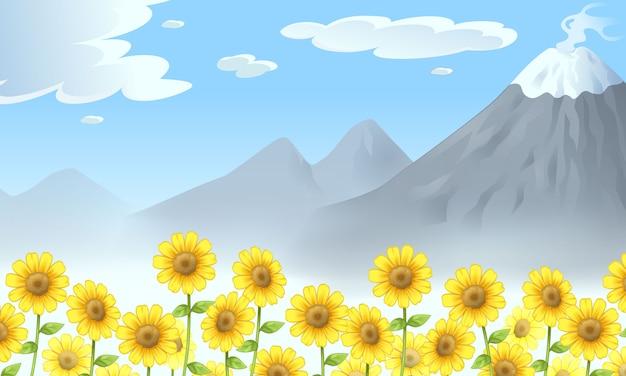 山とヒマワリのイラストのある風景