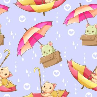 猫と傘の漫画デザインのシームレスパターン