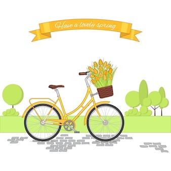 サイクリングパークの背景に黄色のレトロな自転車。カラフルなビンテージバイク。