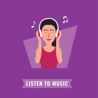 音楽を聴く大きなヘッドフォンの女性