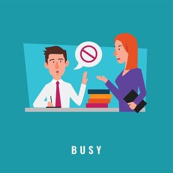 書類の山とオフィスで働く忙しいビジネスマン