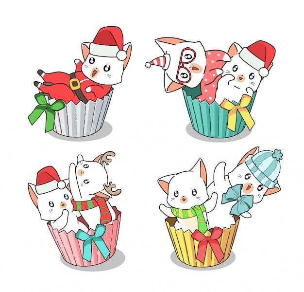 クリスマスの日にカップケーキの中の手描きの愛らしい猫キャラクター