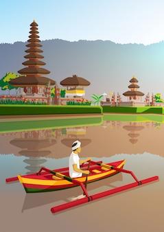 バリの男とウルンダヌ寺院、インドネシアのバリ島で伝統的なボートに乗る