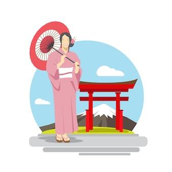 富士山の背景の前に傘を持つ日本女性