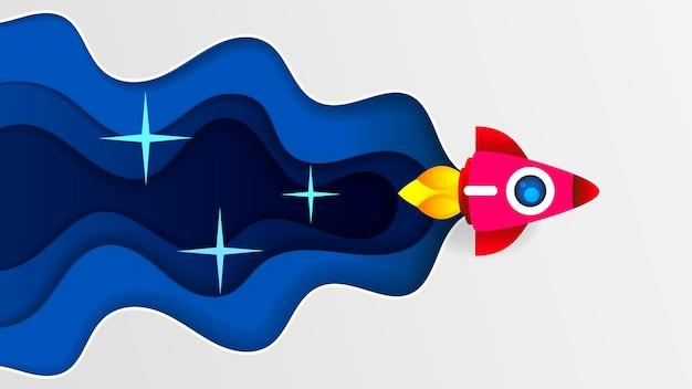 白いトーンの背景を持つペーパーロケットペーパーアート