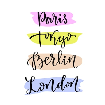 Ручная надпись. векторные современные каллиграфические надписи. столичные города мира - париж токио берлин лондон
