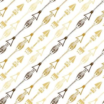 ゴールドカラーの民族の矢のシームレスな背景。手描きの矢印ベクトルパターン。