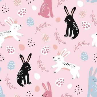 飾られた塗られたイースターエッグとウサギとハッピーイースターのシームレスなパターン。