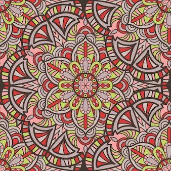 マンダラベクトルのシームレスなパターン背景。部族の飾り。
