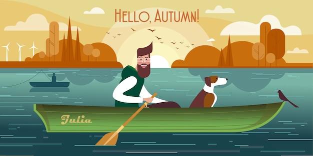 ボートに乗って犬と若い男。秋の釣りの