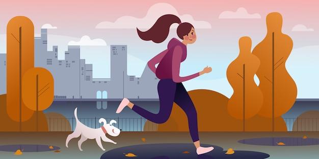 堤防沿いの秋の公園で犬とジョギングする少女。都市通りのシーン。
